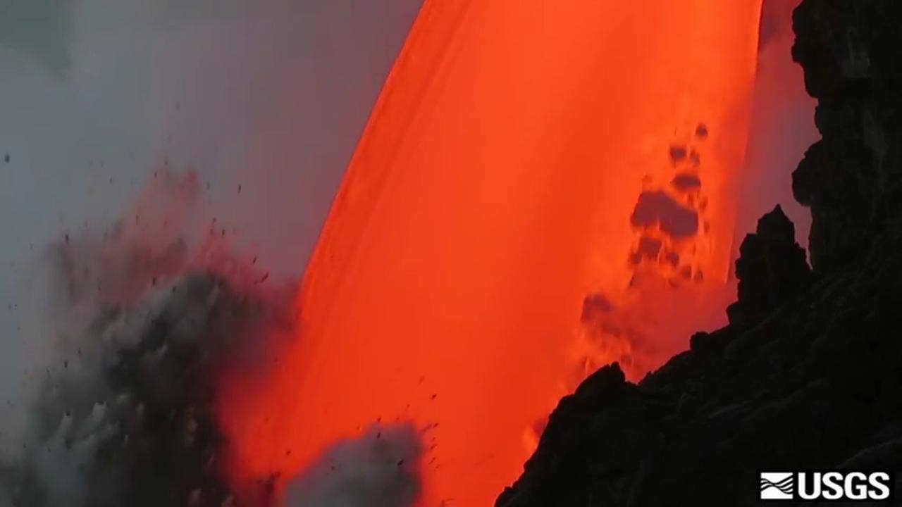 Massive stream of lava plunges into sea in stunning new video