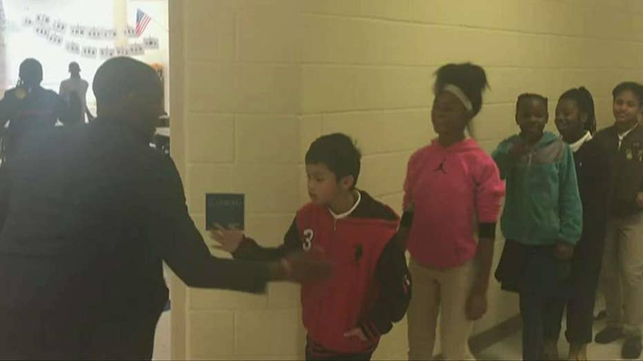 Teacher fires up students with personalized handshakes