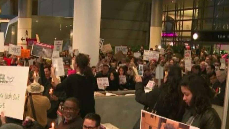Confusion at airports after judge blocks Trump's travel ban