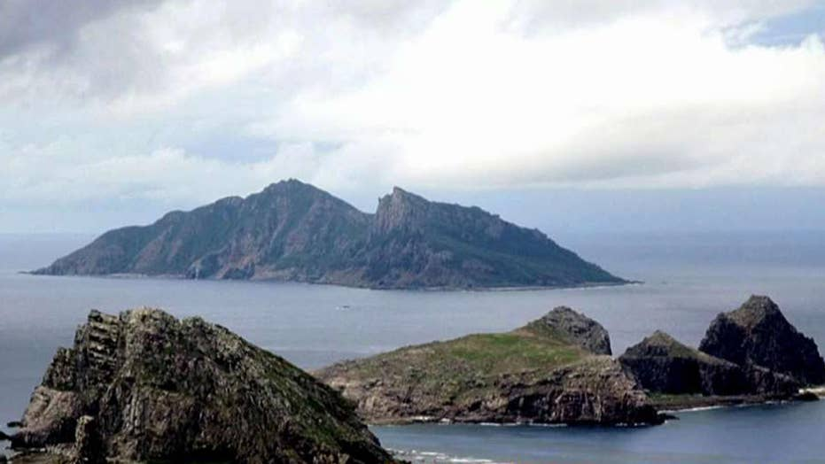 China sails warships near disputed islands in East China Sea