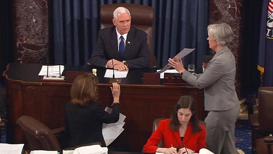 Pence casts historic tie-breaking vote to confirm DeVos