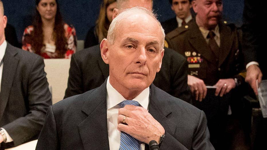 DHS chief maintains commitment to the wall, travel ban