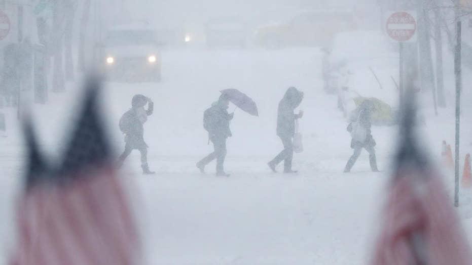 Massive snowstorm slams Northeast, snarls travel