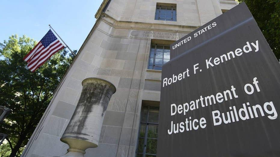Justice Department responds to ruling on travel ban