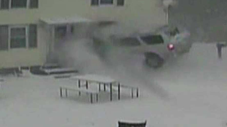 Out-of-control SUV slams into home