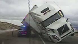 Strong winds blow big rig over on highway