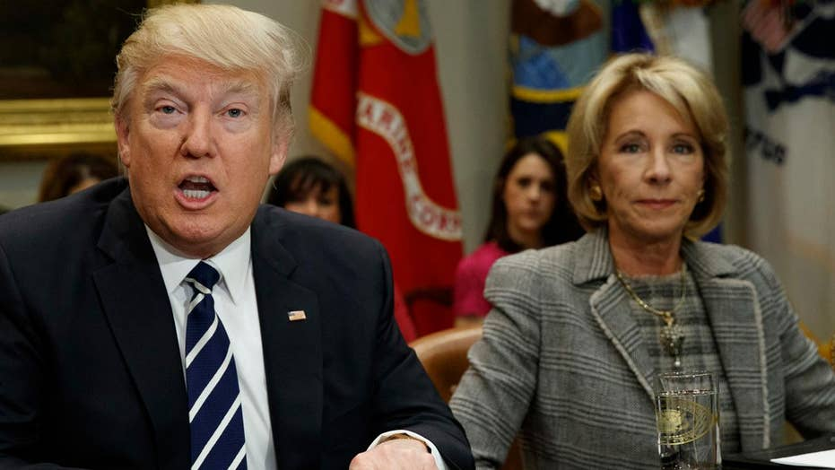 Trump praises DeVos for her 'toughness' and 'genius'