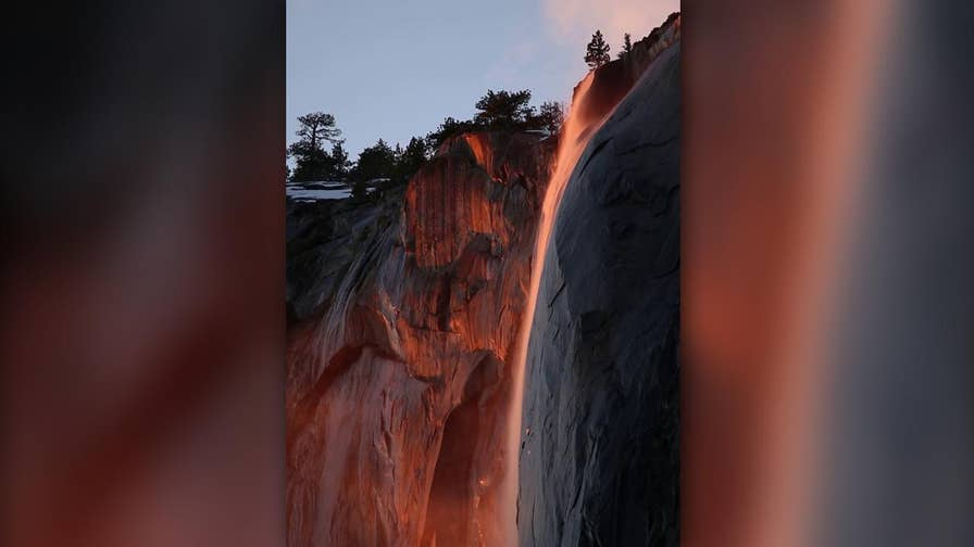Raw video: Horsetail Fall glows orange and red by setting sun