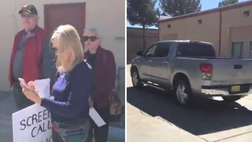 Raw video: Head staffer for New Mexico Congressman Steve Pearce drives away from constituents demanding town hall meeting