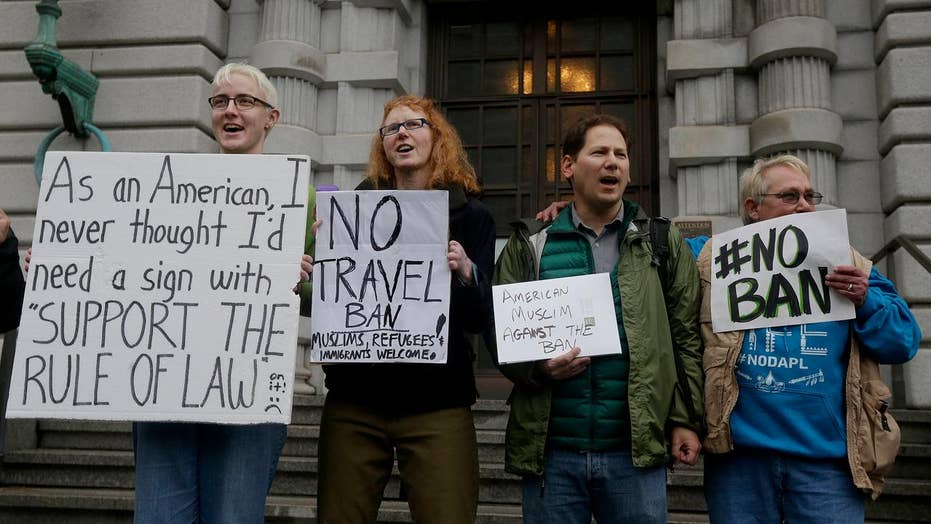 What must revised travel ban do to clear legal hurdles?