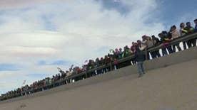 Hundreds line up along U.S.-Mexico border