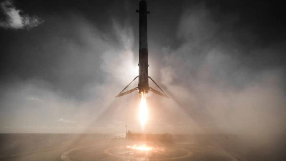 'Falcon has landed': SpaceX booster returns to Earth