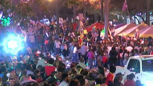 Car crashes into Mardi Gras crowd, injuring at least twelve