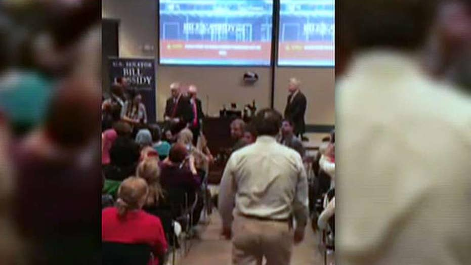 Protesters disrupt prayer at Sen. Bill Cassidy's town hall