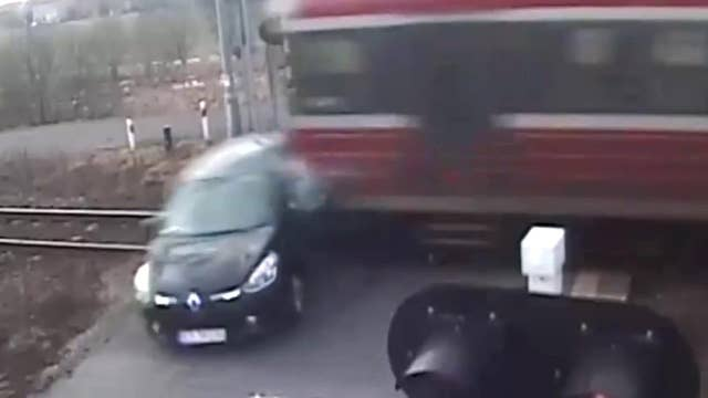 Moment of impact: Driver tries to beat speeding train, loses