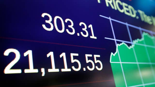 Dow hits historic high after Trump's address to Congress