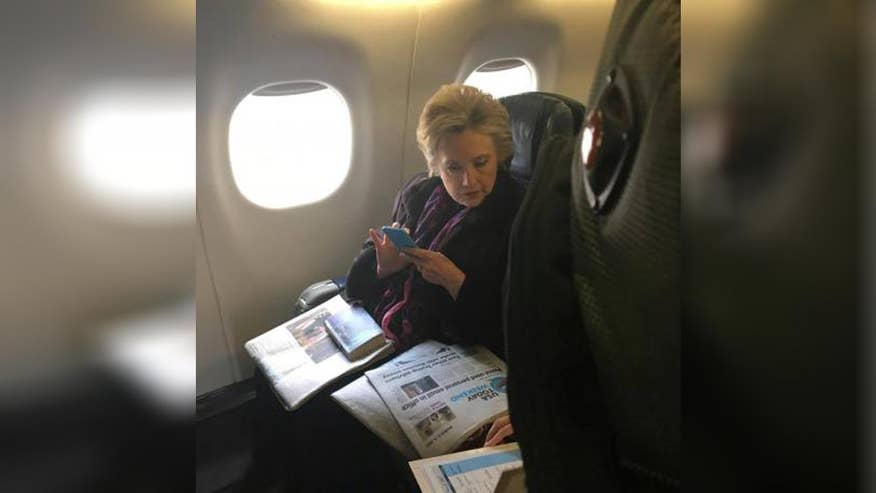 Some find viral image of Hillary Clinton reading news story about Mike Pence's email to be ironic