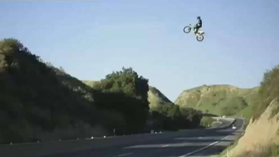 Dirt bike jumps over the freeway