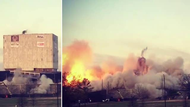 Implosion reduces Georgia's 'White Ice Cube' to rubble
