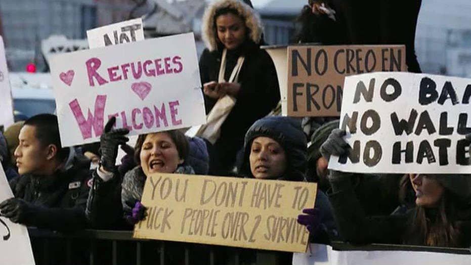 Immigration advocates pledge to fight new travel order