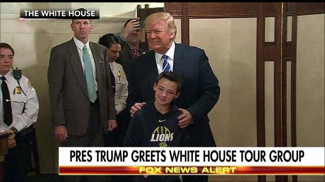 Trump greets visitors
