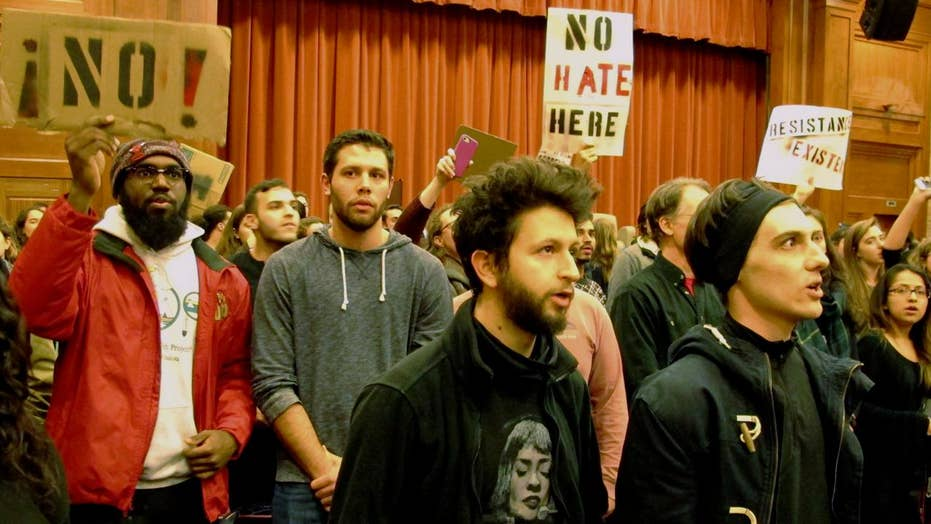 Protesters confront scholar at Middlebury College