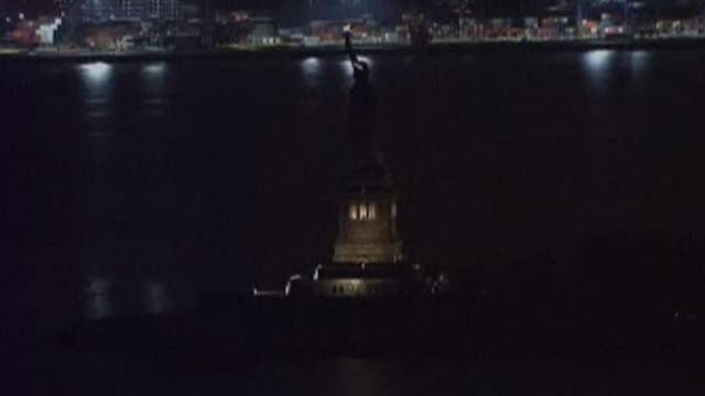 Statue of Liberty goes dark and raises questions