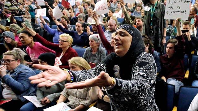 Washington joins states challenging revised travel ban