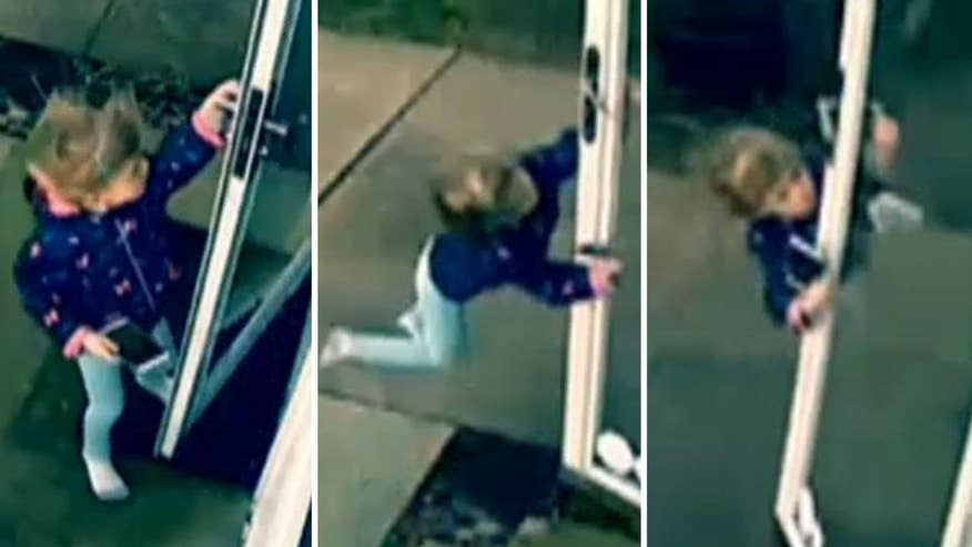 Raw video: 4-year-old holds on tight to door as gust of wind sends them both flying in Ohio