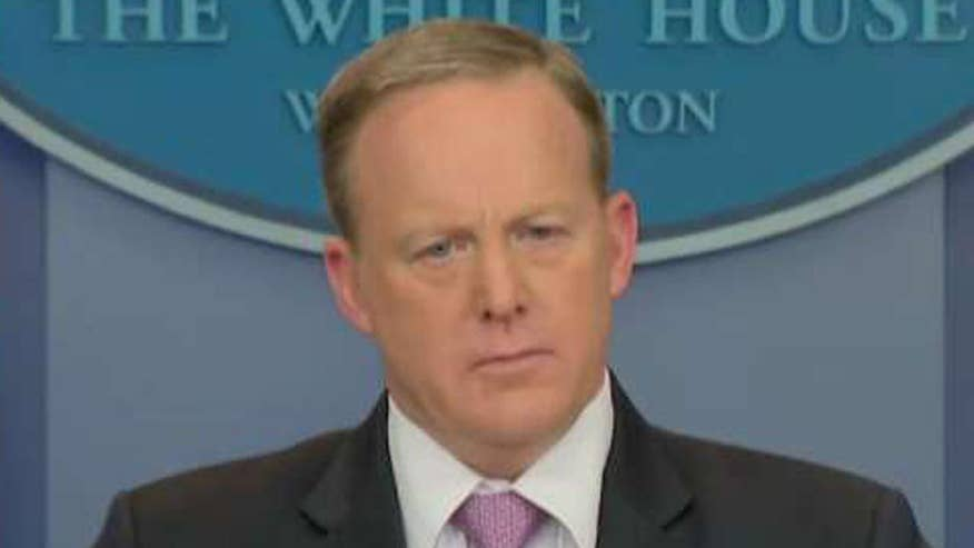 White House press secretary holds daily press briefing