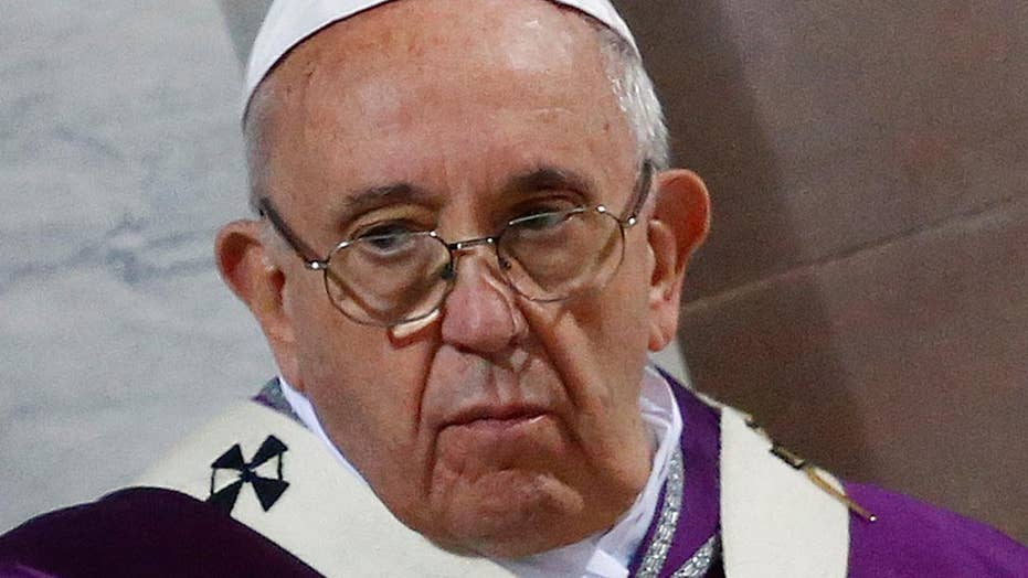 Pope Francis signals openness to ordaining married priests