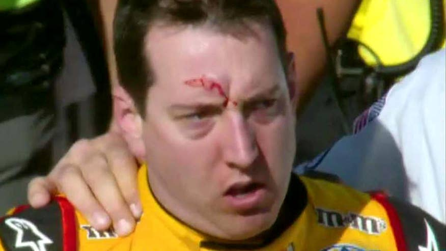 Kyle Busch left with gash on forehead after confronting Joey Logano on pit road after the pair was involved in crash on final lap of the Kobalt 400 in Las Vegas