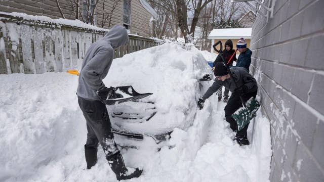 Blizzard brings extreme snowfall totals, grounds flights