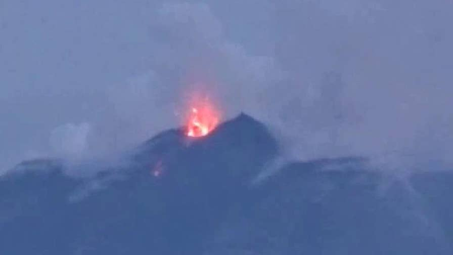 Raw video: Europe's largest and most active volcano shoots debris into air