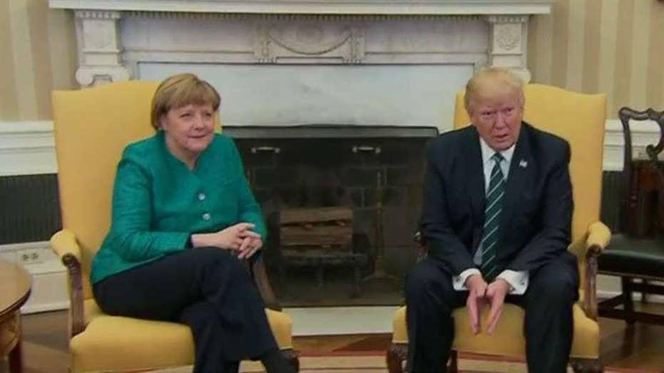 Handshake missing from Trump-Merkel photo op?