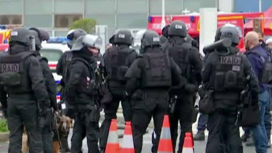 Suspected terrorist attacks airport in Paris
