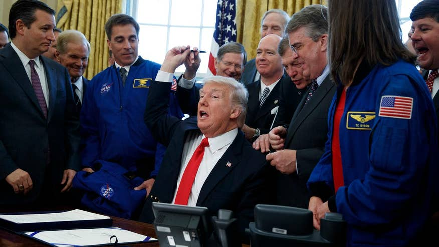 President Donald Trump signs new bill into law, authorizing $19.5 billion in funding to NASA to further space exploration and develop manned missions to Mars