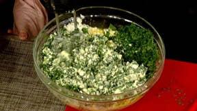 Mike Emanuel and his family prepare Greek dish