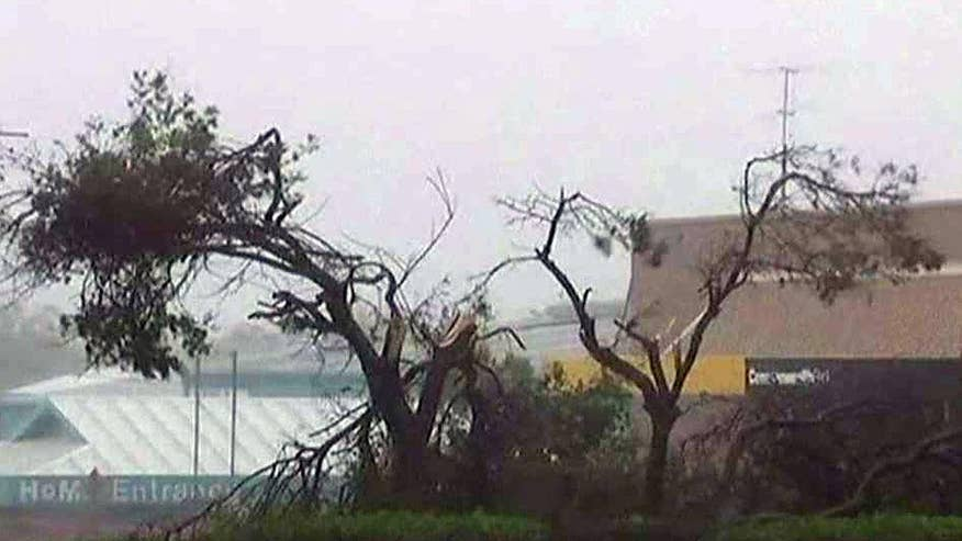 Strong winds and heavy rain knocked out power to tens of thousands of homes and forced residents to evacuate