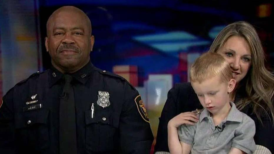 Viral video shows 3-year-old hug officer sitting alone