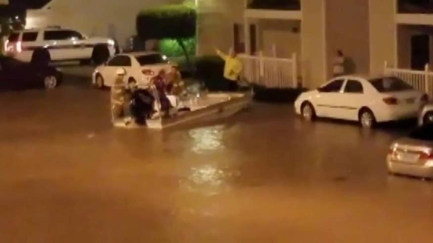 Flooding forces just under 60 residents to be evacuate to a nearby hotel. Local authorities used boats to transport people to dry land.