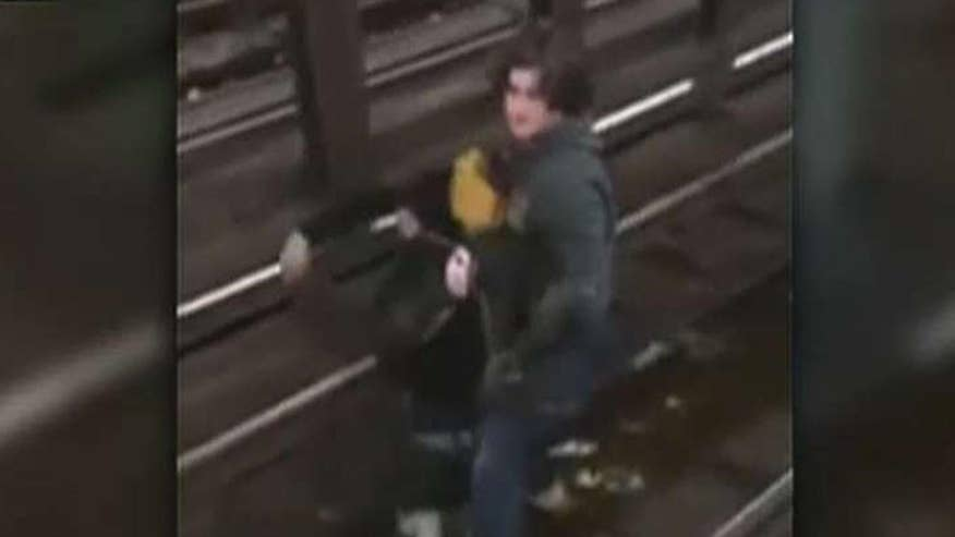Man jumps onto tracks just before train arrived