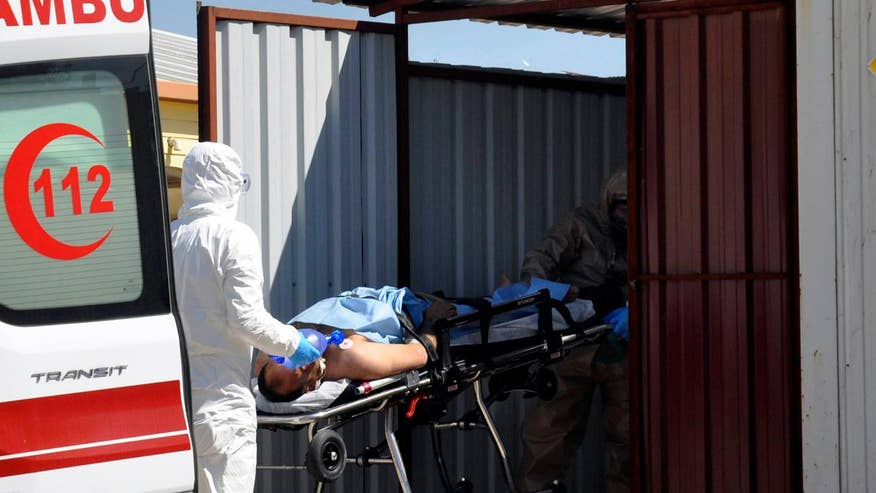 Image result for 100 dead in suspected chemical attack in Syria