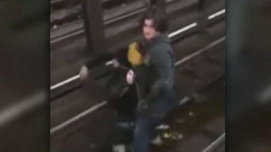 Hero saves boy from NY subway tracks