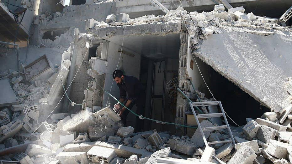 Suspected chemical weapons attack kills dozens in Syria
