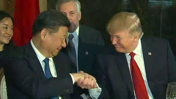 Trump says he won't label China a currency manipulator