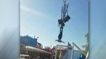 Woman left flying through the air dangling by her feet after carnival ride mishap in Paris