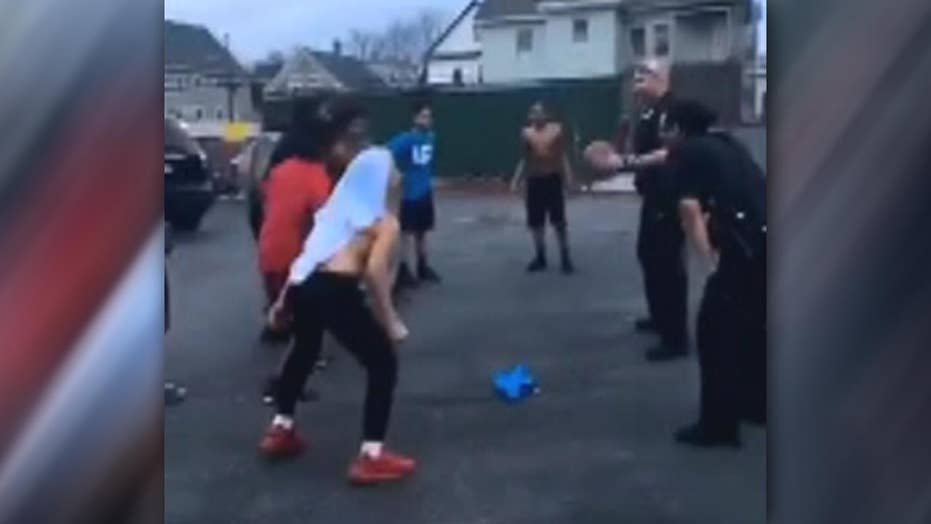 Cops play pickup game of basketball with group of kids
