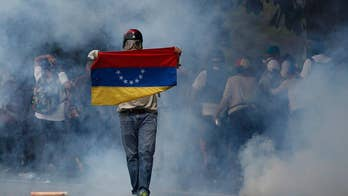 Venezuelan protester shot dead during violent 'mother of all marches'