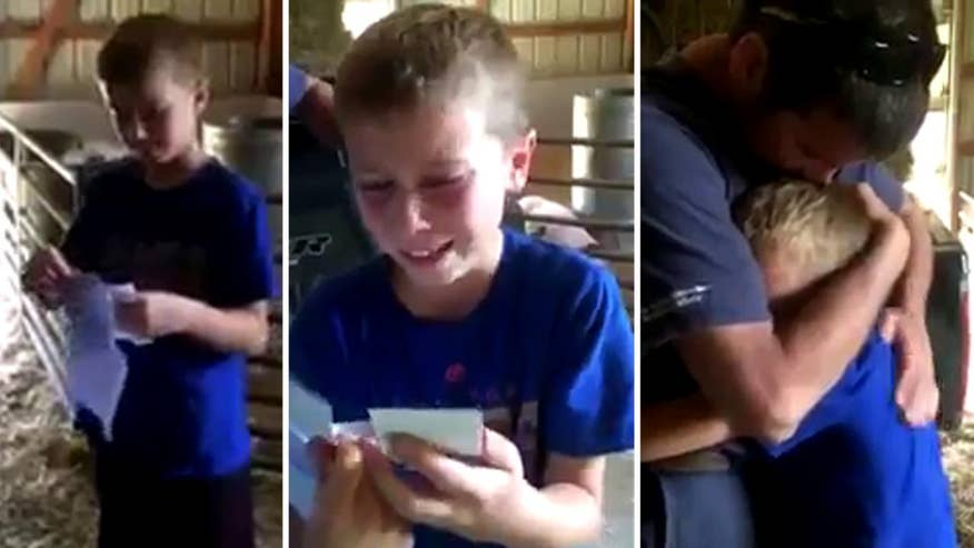 Raw video: Dad in Indiana rewards son for working hard in school and around the family farm